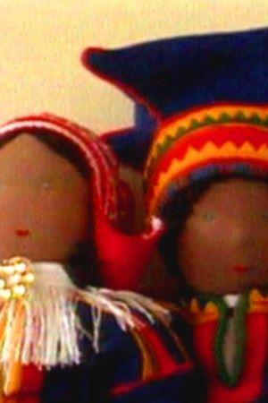 Två dockor, den ena föreställer en samisk kvinna, den andra en samisk man