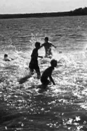 Barn i solglittrande hav