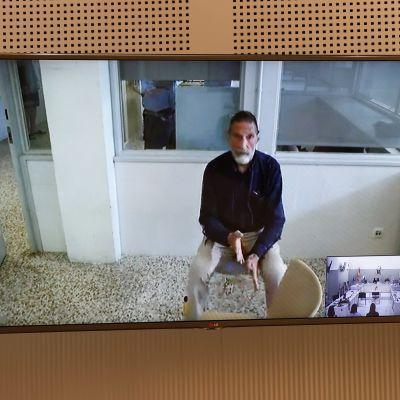 John McAfee hörs per videolänk under en utlämningsförhandling den 15 juni 2021 i Spanien.