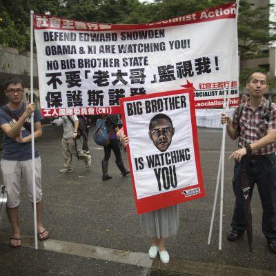 Demonstration för Edward Snowden i Hongkong.