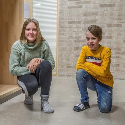 Victoria Mäkeläinen och Aron Skog på huk
