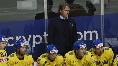 Johan Garpenlöv och svenska spelare blickar tomt mot planen.