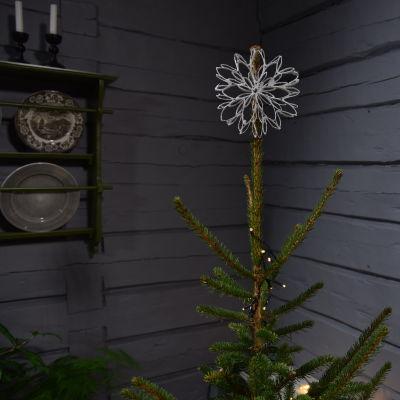 Julstjärna gjord av toapappersrullar med sockeryta.
