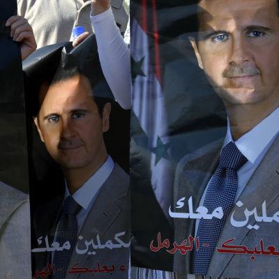 Syriens president Bashar al-Assad på valaffischer inför valet i maj, då han återvaldes.