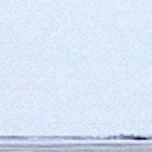 Inarijärven erakkokalastaja Eemeli Nikula järven jäällä.