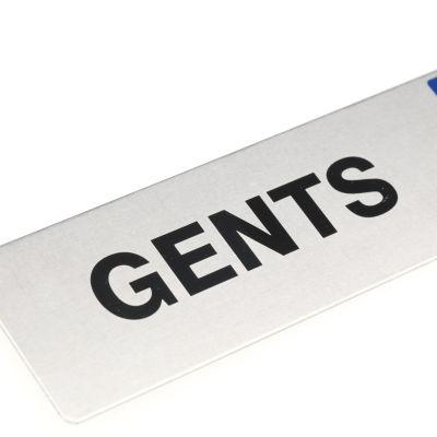 """en skylt med """"Gents"""" text"""