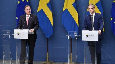 Bild på två män i kostym.