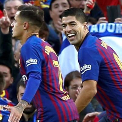 Philippe Coutinho och Luis Suarez firar mål.