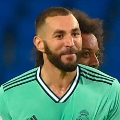 Marcelo kramar Karim Benzema bakifrån.