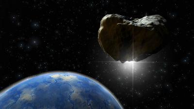 En asteroid närmar sig jorden i artistens vision.
