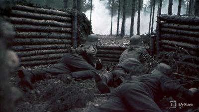 Sotilaat ampumapesäkkeessään.