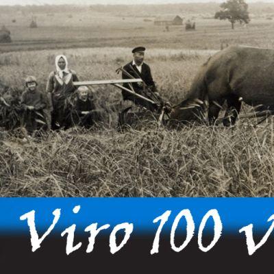 Vironen perhe viljankorjuussa. Vanhan ajan leikkuupuimuria vetää kaksi hevosta.