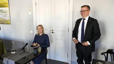 Samlingspartiets ordförande Petteri Orpo och Sannfinländarnas ordförande Riikka Purra.
