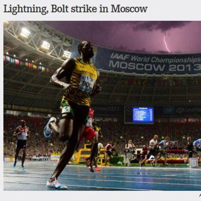 Usain Bolt med blixt i bakgrunden