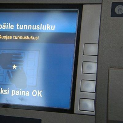 Pankkiautomaatin näyttöruutu.