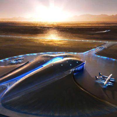 Jättimäinen, pyöreä ja hyvin muovisen futuristinen lentoasema kylpee nousevan auringon hieman oranssisessa valossa.
