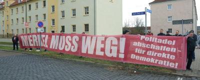 En demonstration mot Angela Merkel