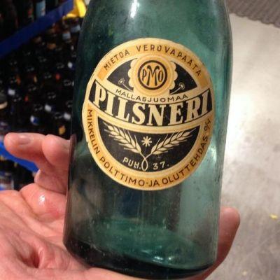 Graanin pullonpalautukseen tuotu vanha lasipullo.