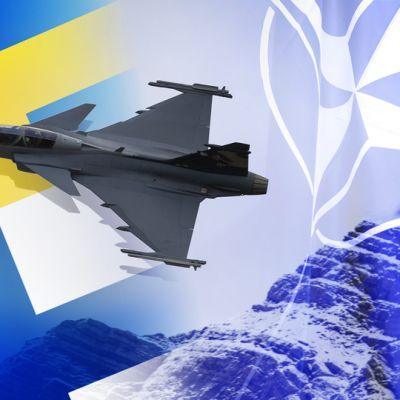 Suomen ja ruotsin ja naton lippuja.