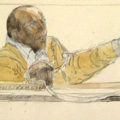 Piirtäjän näkemys Pascal Simbikangwasta oikeudenkäynnissä.
