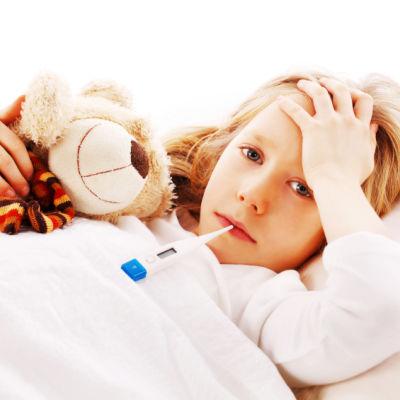 Barn som mäter feber