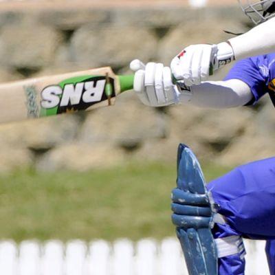 Yleiskuva srilankalaisesta kriketin pelaajasta.