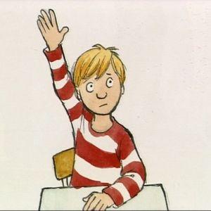 Felix sitter i skolbänken och markerar
