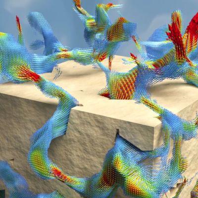 Simuloitu virtauskenttä pienessä näytepalasessa. Suuntavektoreiden punainen väri edustaa nopeaa ja sininen hidasta virtausta, kun taas keltainen sekä vihreä väri edustavat nopeuksia ääripäiden välistä.