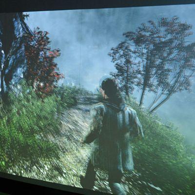 Digitaalinen peli isolla screenillä.