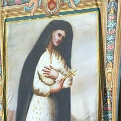 Maalauksessa Kateri Tekakwithan kuva. Tekakwitha kanonisoitiin ja julistettiin pyhimykseksi 21.10.2012.