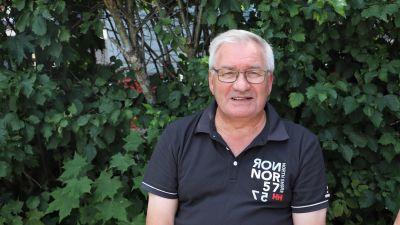 Raimo Tapio, en man med grått hår och glasögon.