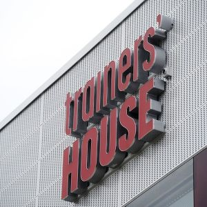 Trainers' House logo.