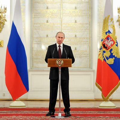 Vladimir Putin pitää puhettaan Kremlissä 28. maaliskuuta 2014.