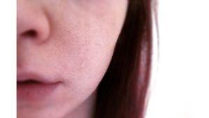 osa naisen kasvoista