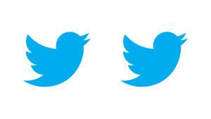 Twitterlogo, två blåa fåglar.