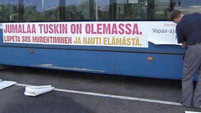 Fritänkarnas och Humanistförbundets reklamtext på en buss.