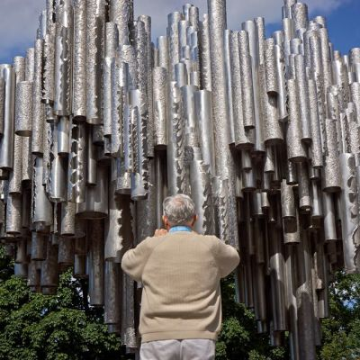 Tourist photographing Sibelius monument.