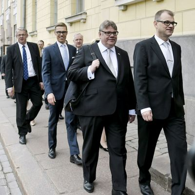 Prime Minister Juha Sipilä leads his new cabinet to the government banquet hall Smolna on Friday.