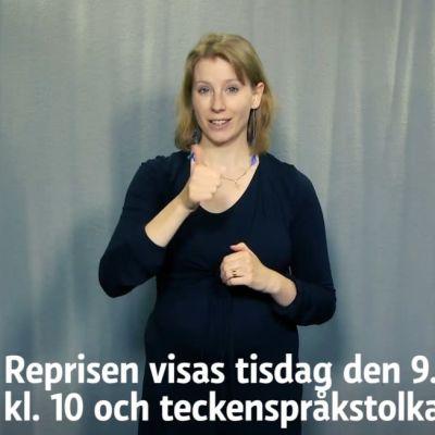 Kvinna som tolkar till teckenspråk
