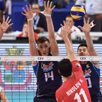 Italia Vladimir Nikolav (red) of Bulgaria spikes the ball Simone Giannelli (L),Matteo Piano (C) and Filippo Lanza (R) of Italy during the bronze medal between Italy and Bulgaria men's 2015 CEV Volleyball European Championship in Sofia, Bulgaria.