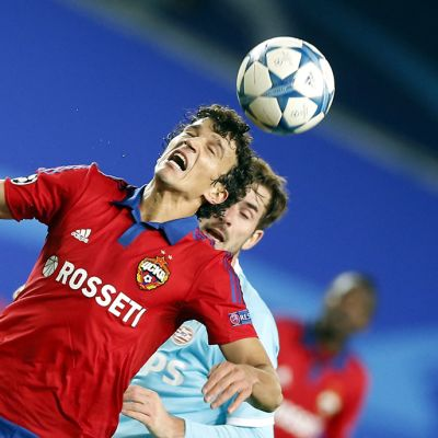 Davy Propper (R) of PSV Eindhoven in action against Roman Eremenko (L) of CSKA Moscow during the UEFA Champions League