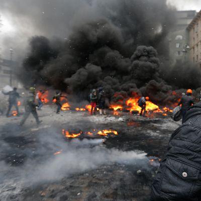 Mielenosoittaja ja palavia renkaita