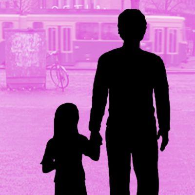 Isän ja tyttären silhuetti.