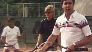Tennisspelare på planen.