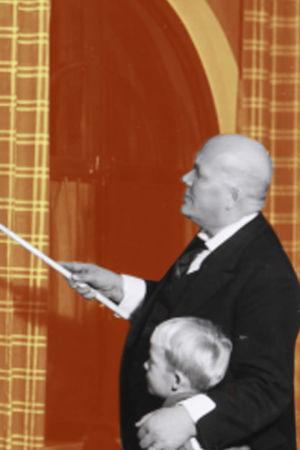 Vanha mies näyttää karttakepillä karttaa pienelle pojalle