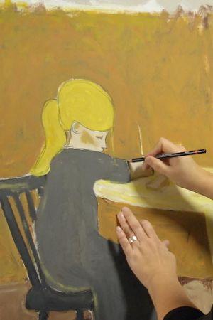 Camilla Forsén-Ström målar tavla vid staffli.