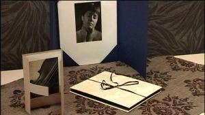 Pappersvikning för fotografier
