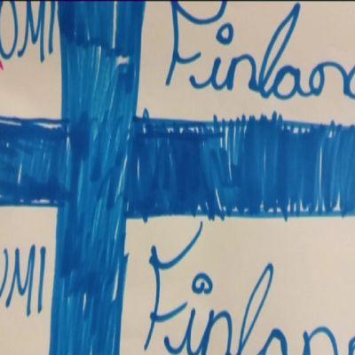 Piirros Suomen lipusta.