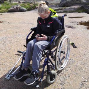 Redskapsgymnasten Enni Kettunen i rullstol.