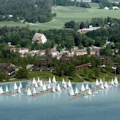 En flygbild över Ingå centrum där nya hus och båtbryggor finns inritade.